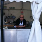 Mr. Shopkeeper in our field kitchen.